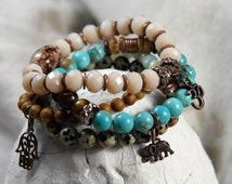 Set of 4 of Buddhist Yoga bracelets with semi-precious stones, charms, and Czech Facettglasperlen
