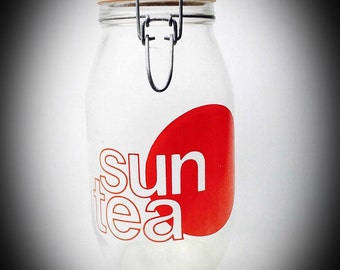 vintage glass Sun Tea jar with latched lid red circle design