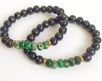Green jade and black beaded bracelet