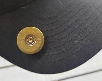 12 gauge shotgun shell end pin, for hats, backpacks, jackets, etc.