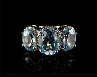 Spectacular 3.20ct Blue Topaz & Diamond Trilogy Gold Ring