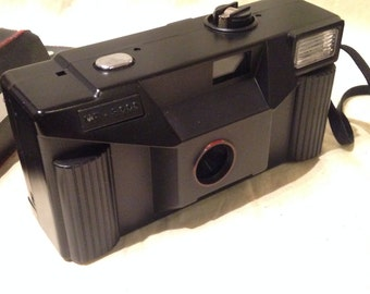 Retro 1980's Black Stills Film Photo Camera With Flash & Focus Free - MF 5000.  Original 80's film camera.