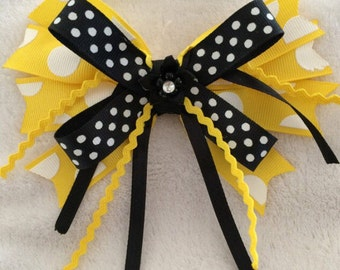 Yellow and black bow for order