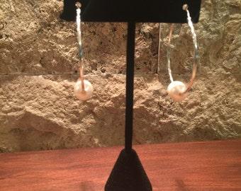 Sterling silver hoop earrings with a freshwater pearl