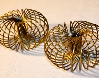 Mid-century slinky brass wire candle holders