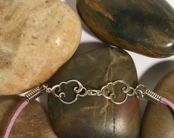 Expandable leather bracelet with sterling silver charm...'Clouds'.  Art You Can Wear