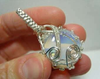 Beautiful Opalite tumble stone pendant with a silver plated knitted wire setting