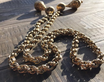 """31.5"""" Gold colored chain with decorative ends"""