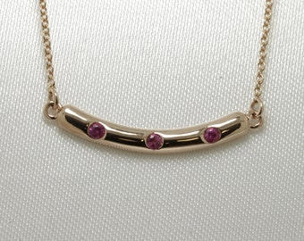 ruby 9ct rose gold ladies rub over set curved pendant