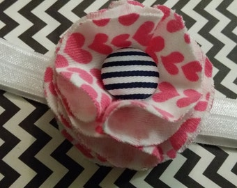 fabric flower with button on white headband