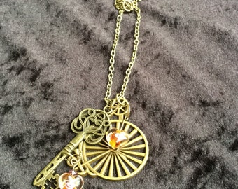 Steampunk penny farthing and key necklace