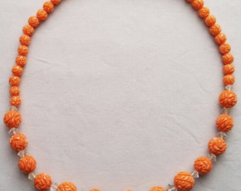 Coral Coloured Carved Lucite Necklace