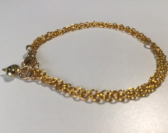 Delicate gold plated bracelet and drop earrings