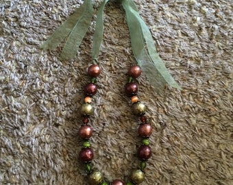Necklace-beaded w/green ribbon tie-green,rust, beige beads w/brass detail in between beads