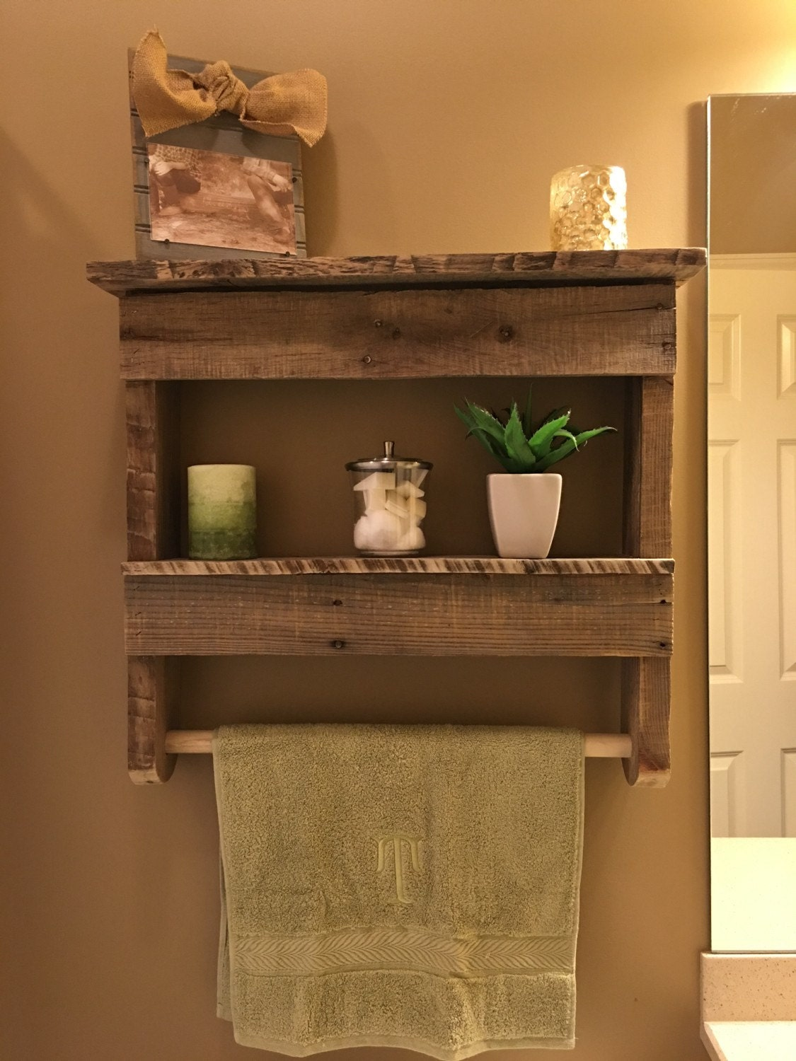 rustic bathroom shelf with towel hanger