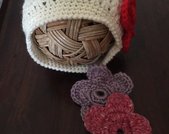 A baby girl's hat with interchangeable flowers