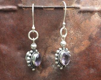 Bali silver earrings with set amethyst stones.