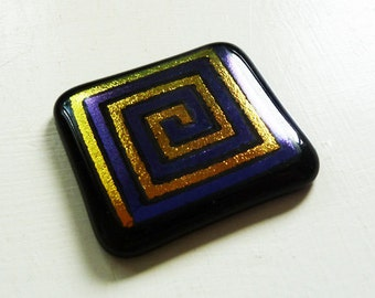 Dichroic cabochon - large black, purple and gold fused glass with purple and gold square spiral