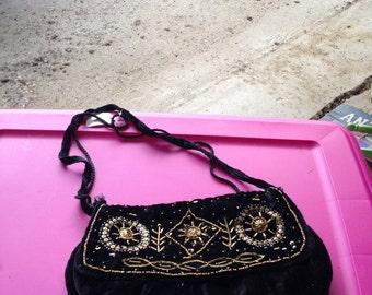 Lovely black velvet handbag outlived in beautiful gold
