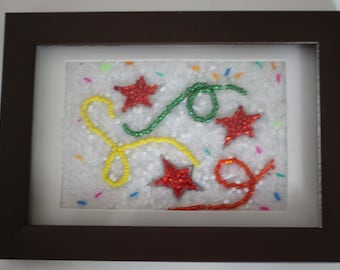 Beaded picture of stars and streamers, celebrate