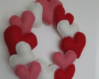 Wreath made of felt harts, red, pink and white. Great for a wedding or valentine.