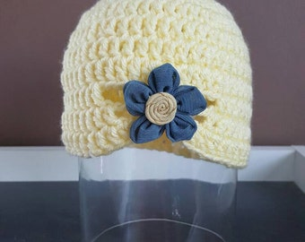 Yellow hat with flower