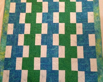 Turquoise and green stacked block quilt