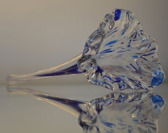 Hand blown clear glass flower with blue and white streaks