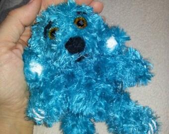 crocheted turquoise Teddy bear glass eyes