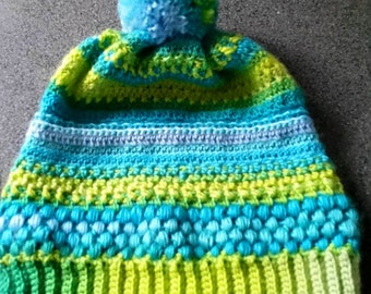 Pretty crocheted hat with PomPoms