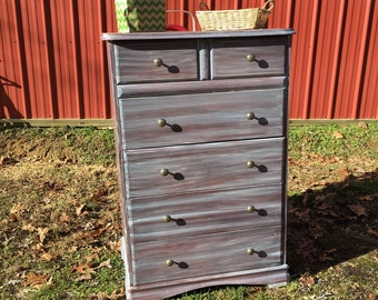 Tall dresser done in a weathered wood look