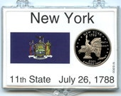 """2001 New York Clad Proof Statehood Quarter displayed in a 3"""" x 2"""" Marcus Snap Loc holder."""