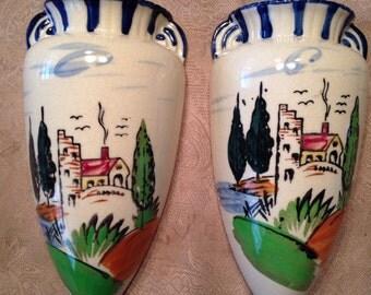 Vintage pair of wall vases