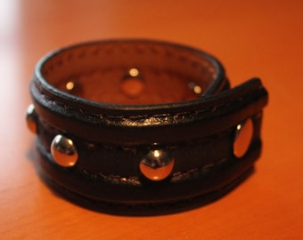 upcylced/recycled black leather cuff with domed studs