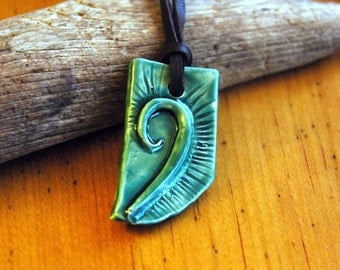 Green ceramic pendant necklace with swirl