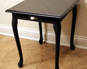 Black Accent Table With Stenciling on Top
