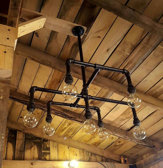 Industrial lighting chandelier iron pipe by farmsteadironworks for Iron pipe ceiling light