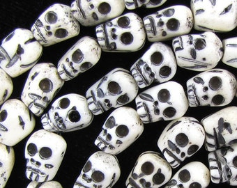 "8x10mm black white hand carved ox bone skull beads 8"" strand"