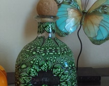 Polymer Clay Covered Patron Bottle.
