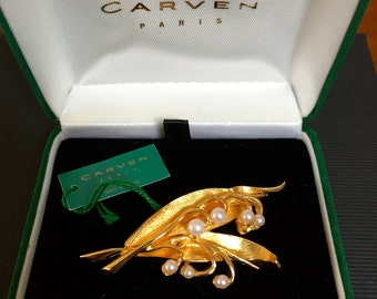 Carven pin