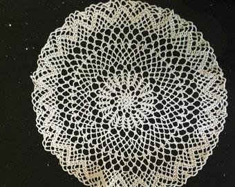 Hand crocheted white doily