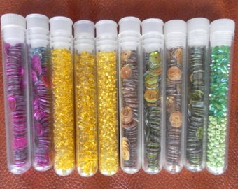 Ten tubes of beads and sequins