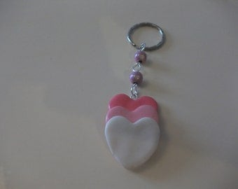 The three small heart with its beads Keychain pink