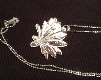 Flower pendant crafted in fine silver