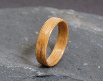 Wooden ring made with American Walnut, using the bentwood technique. Custom unique birthday, anniversary, or Christmas gift for him or her.