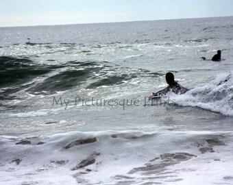 surfer in the water near Porto in Portugal, Algarve