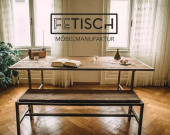 Dining table made of solid wood and brushed steel