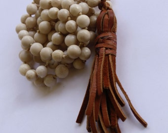 bone knotted with handmade suede tassel