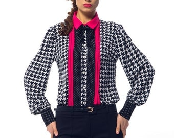 Stylish women's blouse with long sleeves.
