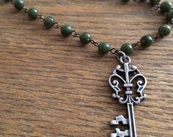 Vintage key charm on green beads